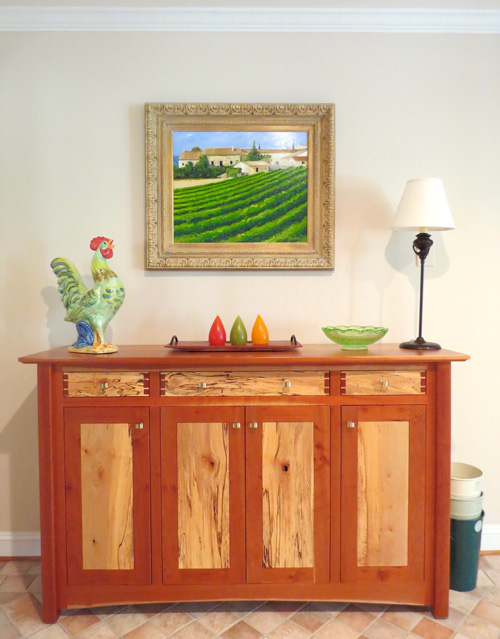 Decorating with art like Sainte Ser Vineyard by Tom Neel suggests a love of wine, vineyards, travel, or good friends.